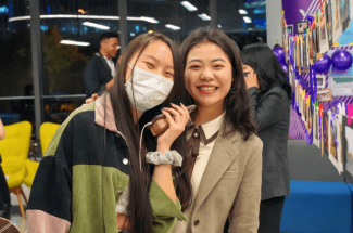 "Students gathered at the Lujiazui Cafe before the ceremony to take pictures and reminisce at different stations. The space was decorated to feel like an old train, ""No.88,"" traveling in time between Shanghai to New York to encourage students to celebrate their pasts and futures."