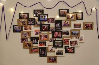 Committee members adorned the walls of the second floor  with photos commemorating the Class of 2021's years at NYU Shanghai:  2017's Orientation Week and Reality Show, club events, academic presentations, sporting events, and school trips.